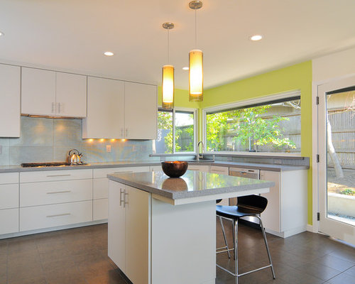 Example Of A Minimalist Kitchen Design In Sacramento With Flat Panel  Cabinets, White Cabinets