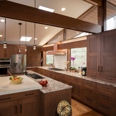 Eat-in kitchen - craftsman l-shaped eat-in kitchen idea in Wilmington with recessed-panel cabinets, stainless steel appliances, subway tile backsplash, medium tone wood cabinets, an undermount sink, granite countertops and beige backsplash