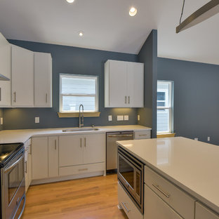 Small modern eat-in kitchen designs - Inspiration for a small modern l-shaped light wood floor eat-in kitchen remodel in Nashville with an undermount sink, flat-panel cabinets, white cabinets, quartzite countertops, metallic backsplash, metal backsplash, stainless steel appliances and an island