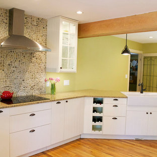 Farmhouse kitchen photos - Kitchen - country medium tone wood floor kitchen idea in Vancouver with a farmhouse sink and stainless steel appliances