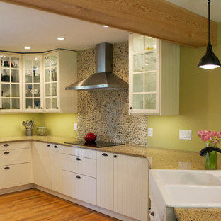 Farmhouse kitchen ideas - Inspiration for a farmhouse medium tone wood floor kitchen remodel in Vancouver with a farmhouse sink and stainless steel appliances
