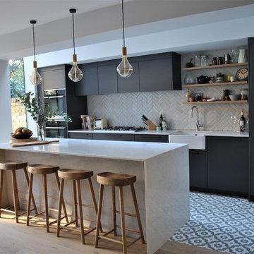 Modern dark grey kitchen with black handles
