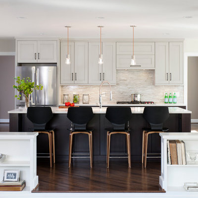 Large transitional galley dark wood floor open concept kitchen photo in DC Metro with a double-bowl sink, shaker cabinets, gray cabinets, quartz countertops, mosaic tile backsplash, stainless steel appliances, beige backsplash and an island