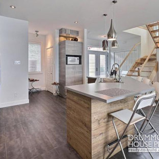 Trendy single-wall ceramic floor eat-in kitchen photo in Miami with a drop-in sink, beaded inset cabinets, light wood cabinets, concrete countertops, stainless steel appliances and an island