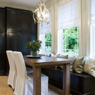 Eat-in kitchen - large traditional galley light wood floor eat-in kitchen idea in Chicago with raised-panel cabinets, dark wood cabinets, stainless steel appliances and an island