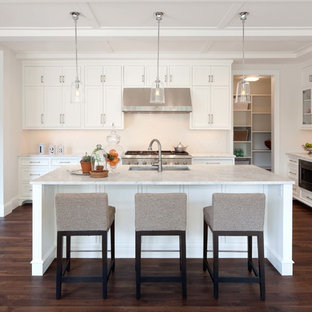 Traditional kitchen ideas - Kitchen - traditional kitchen idea in Minneapolis with an undermount sink, recessed-panel cabinets, white cabinets, white backsplash and stainless steel appliances