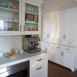 Mid-sized transitional kitchen pantry remodeling - Inspiration for a mid-sized transitional u-shaped kitchen pantry remodel in Chicago with shaker cabinets, white cabinets, marble countertops, white backsplash and an island