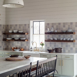Transitional kitchen ideas - Inspiration for a transitional kitchen remodel in Boston with a farmhouse sink, open cabinets, multicolored backsplash and an island