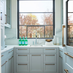 Traditional u-shaped kitchen pantry in Minneapolis with a submerged sink, shaker cabinets, window splashback, light hardwood flooring and beige floors.