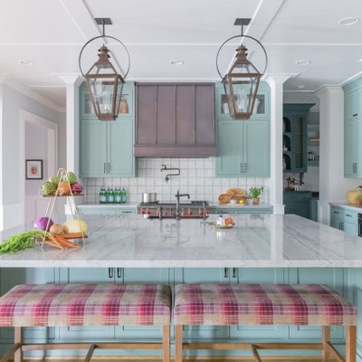Large cottage l-shaped light wood floor and beige floor open concept kitchen photo in Houston with stainless steel appliances, a farmhouse sink, shaker cabinets, turquoise cabinets, marble countertops, white backsplash, ceramic backsplash, an island and white countertops