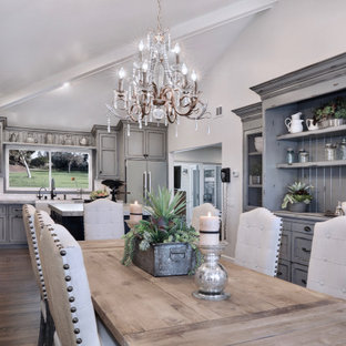 Mid-sized french country eat-in kitchen designs - Eat-in kitchen - mid-sized french country l-shaped dark wood floor and brown floor eat-in kitchen idea in Orange County with a farmhouse sink, shaker cabinets, gray cabinets, marble countertops, white backsplash, ceramic backsplash, stainless steel appliances, an island and gray countertops