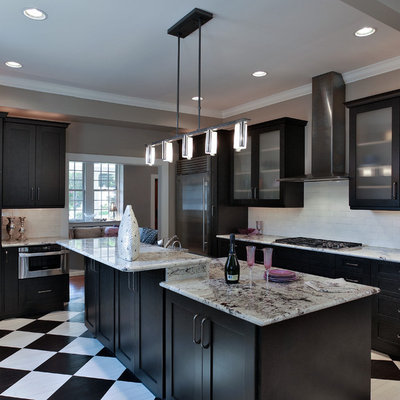 Transitional l-shaped painted wood floor and multicolored floor kitchen photo in Baltimore with glass-front cabinets, white backsplash, subway tile backsplash and stainless steel appliances