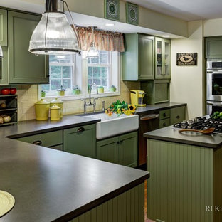 Design ideas for a large country u-shaped eat-in kitchen in Providence with a farmhouse sink, shaker cabinets, green cabinets, granite benchtops, yellow splashback, ceramic splashback, stainless steel appliances, medium hardwood floors and with island.