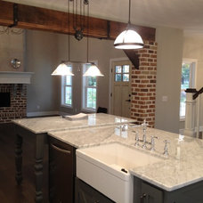 Farmhouse Kitchen by Rembrandt Homes Inc.