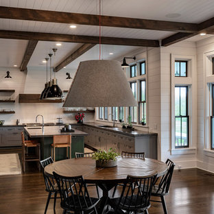 Large farmhouse eat-in kitchen pictures - Large cottage u-shaped dark wood floor and brown floor eat-in kitchen photo in New York with a single-bowl sink, gray cabinets, concrete countertops, stainless steel appliances, an island, black countertops, white backsplash, wood backsplash and shaker cabinets