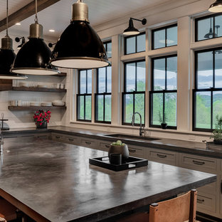 Large farmhouse eat-in kitchen designs - Example of a large farmhouse u-shaped dark wood floor and brown floor eat-in kitchen design in New York with a single-bowl sink, shaker cabinets, gray cabinets, concrete countertops, white backsplash, wood backsplash, stainless steel appliances, an island and black countertops