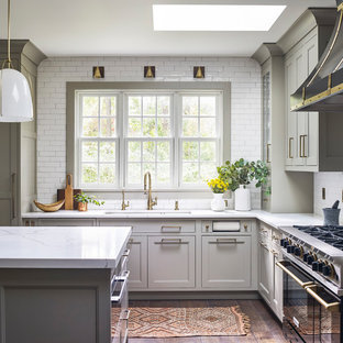 Large farmhouse eat-in kitchen inspiration - Large cottage l-shaped medium tone wood floor and brown floor eat-in kitchen photo in New York with a double-bowl sink, quartz countertops, white backsplash, ceramic backsplash, black appliances, an island, white countertops, recessed-panel cabinets and gray cabinets