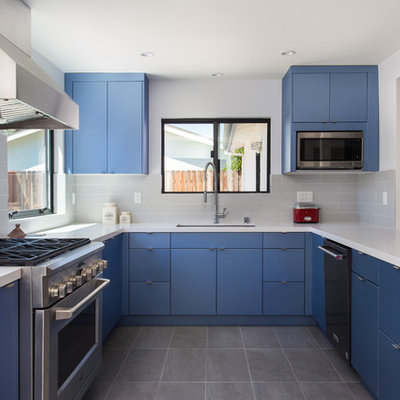 Example of a small trendy u-shaped porcelain tile and gray floor eat-in kitchen design in Los Angeles with an undermount sink, flat-panel cabinets, blue cabinets, quartz countertops, gray backsplash, subway tile backsplash, stainless steel appliances, no island and white countertops