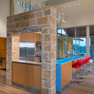 Inspiration for an expansive retro u-shaped kitchen/diner in Austin with a submerged sink, flat-panel cabinets, medium wood cabinets, glass worktops, beige splashback, mosaic tiled splashback, stainless steel appliances, porcelain flooring, no island and blue worktops.