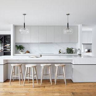 Design ideas for a large contemporary galley kitchen in Melbourne with with island.