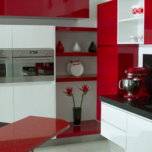 This is an example of a large modern kitchen with flat-panel cabinets, white cabinets and with island.