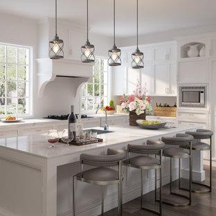 Ispirazione per una piccola cucina moderna con lavello da incasso, ante a filo, ante bianche, top in cemento, paraspruzzi bianco, paraspruzzi in mattoni, elettrodomestici bianchi, pavimento in compensato, isola, pavimento marrone e top bianco