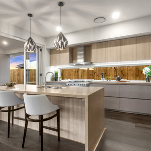 Design ideas for a mid-sized contemporary l-shaped kitchen in Brisbane with an undermount sink, flat-panel cabinets, light wood cabinets, brown splashback, timber splashback, stainless steel appliances, with island, grey floor and beige benchtop.
