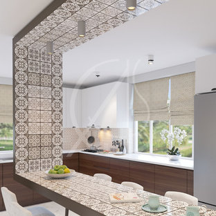Design ideas for a medium sized modern u-shaped kitchen/diner in London with a built-in sink, flat-panel cabinets, brown cabinets, beige splashback, ceramic splashback, stainless steel appliances, marble flooring, an island and beige floors.