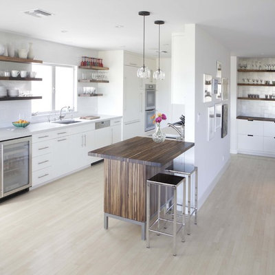 Open concept kitchen - modern galley open concept kitchen idea in Birmingham with paneled appliances, open cabinets and white cabinets