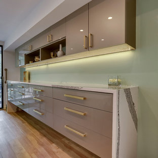 Modern kitchen appliance - Example of a minimalist kitchen design in DC Metro with an undermount sink, flat-panel cabinets, quartz countertops, glass tile backsplash and stainless steel appliances