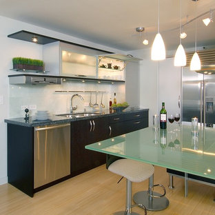 Contemporary kitchen photos - Inspiration for a contemporary kitchen remodel in Hawaii with glass-front cabinets, an undermount sink, dark wood cabinets, glass countertops, stainless steel appliances, white backsplash and green countertops