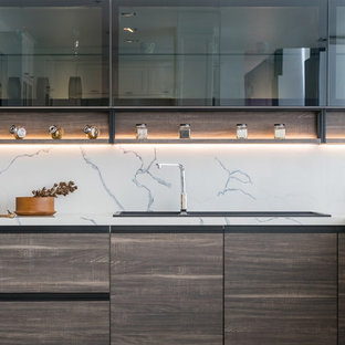 This is an example of a medium sized modern l-shaped kitchen pantry in Los Angeles with no island, a built-in sink, flat-panel cabinets, medium wood cabinets, marble worktops, white splashback, marble splashback, stainless steel appliances and white worktops.