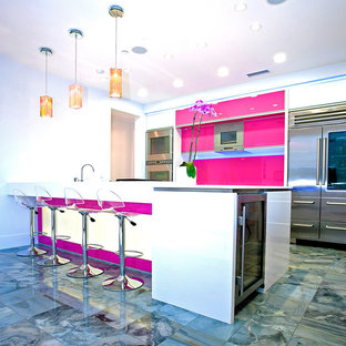 Design ideas for a mid-sized modern separate kitchen in Los Angeles with an undermount sink, flat-panel cabinets, white cabinets, quartz benchtops, stainless steel appliances, marble floors, with island and green floor.