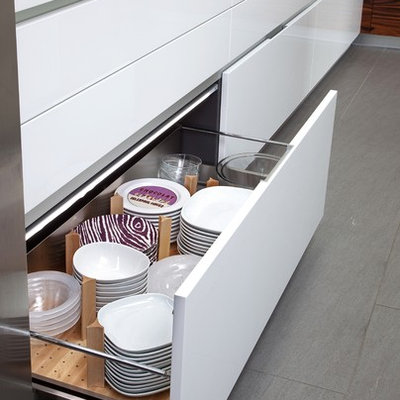 Inspiration for a large modern porcelain tile eat-in kitchen remodel in New York with an undermount sink, flat-panel cabinets, white cabinets, quartz countertops, stainless steel appliances and an island