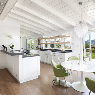 Transitional eat-in kitchen photo in San Francisco with recessed-panel cabinets, a farmhouse sink and white cabinets