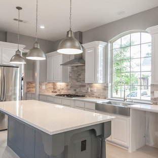 Design ideas for a large modern single-wall open plan kitchen in Dallas with a farmhouse sink, louvered cabinets, white cabinets, quartzite benchtops, grey splashback, ceramic splashback, stainless steel appliances, bamboo floors and with island.
