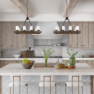 Inspiration for a small country u-shaped eat-in kitchen in Atlanta with a double-bowl sink, beaded inset cabinets, beige cabinets, concrete benchtops, beige splashback, brick splashback, stainless steel appliances, plywood floors, with island, brown floor and white benchtop.