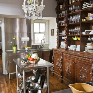 Design ideas for an eclectic kitchen in Other with stainless steel benchtops, an integrated sink, open cabinets, dark wood cabinets, metallic splashback and metal splashback.