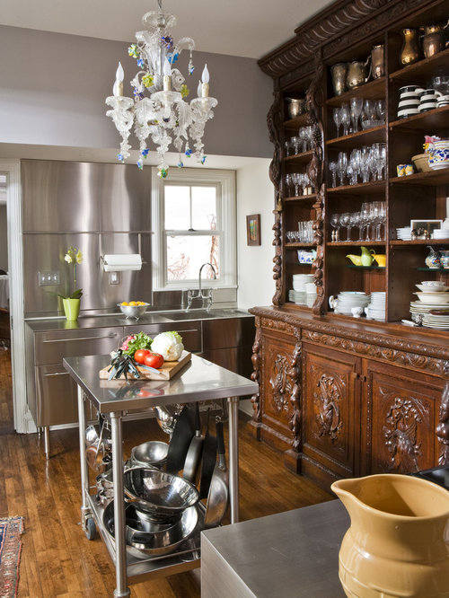 Eclectic kitchen idea in Other with stainless steel countertops, an  integrated sink, open cabinets