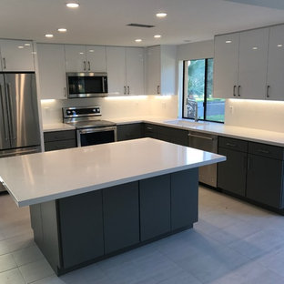 Large modern eat-in kitchen inspiration - Inspiration for a large modern l-shaped porcelain tile and gray floor eat-in kitchen remodel in Other with an undermount sink, flat-panel cabinets, white cabinets, quartzite countertops, white backsplash, stainless steel appliances and an island