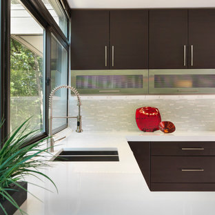 Example of a mid-sized minimalist l-shaped enclosed kitchen design in Providence with an undermount sink, flat-panel cabinets, dark wood cabinets, quartz countertops, gray backsplash, matchstick tile backsplash, stainless steel appliances and no island