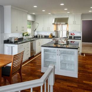 Modern Kitchen With Bold Hardwood Floors & White Flat Panel Cabinets