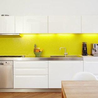 Modern kitchen with yellow mosaic backsplash