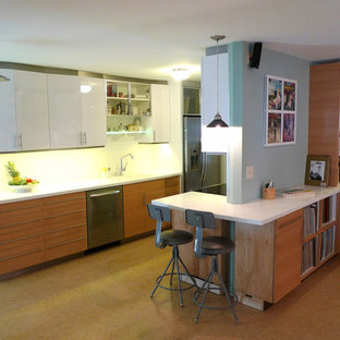 Photo of a medium sized modern l-shaped enclosed kitchen in Los Angeles with a submerged sink, flat-panel cabinets, medium wood cabinets, composite countertops, white splashback, ceramic splashback, stainless steel appliances, plywood flooring, no island and brown floors.