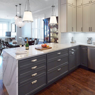 Small farmhouse open concept kitchen designs - Open concept kitchen - small farmhouse u-shaped dark wood floor open concept kitchen idea in Chicago with a farmhouse sink, recessed-panel cabinets, gray cabinets, quartz countertops, white backsplash, subway tile backsplash, stainless steel appliances and a peninsula