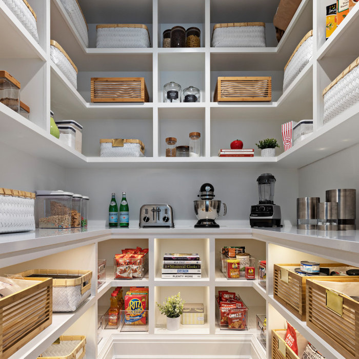 Today's pantries are functional and gorgeous! Our custom pantry creates ample space for every day appliances to be kept out of sight, with easy access to bins and storage containers. Undercounter LED