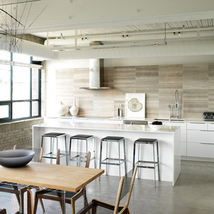 Design ideas for a mid-sized industrial l-shaped eat-in kitchen in Toronto with quartz benchtops, flat-panel cabinets, white cabinets, a double-bowl sink, beige splashback, porcelain splashback, stainless steel appliances, concrete floors, with island and grey floor.