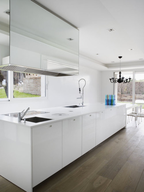 Example Of A Minimalist Eat In Kitchen Design In Madrid With Flat Panel  Cabinets