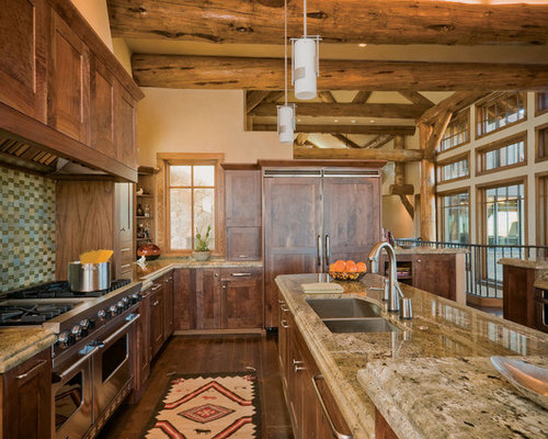 Superior Example Of A Mountain Style Galley Dark Wood Floor Kitchen Design In Denver  With Granite Countertops