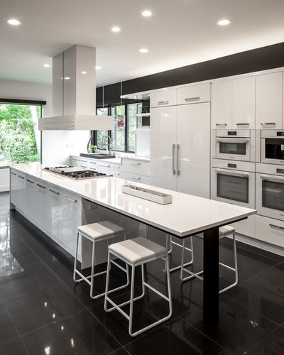 Contemporary Kitchen by Heritage Construction Companies, LLC.